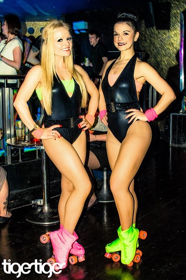 black leotards with neon accessories